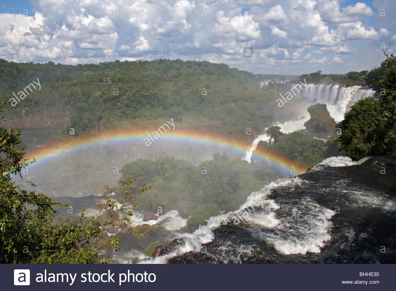 "Spectacular rainbow at the ""Devils Throat"" Iguassu Falls, World Heritage National Park in Argentina. - Stock Image"