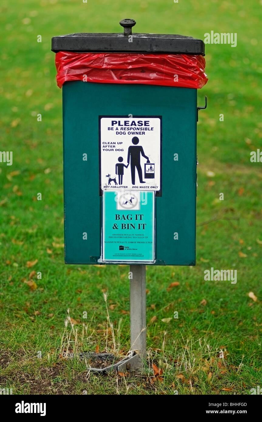 Dog Waste Bin in a Public Park, UK. - Stock Image