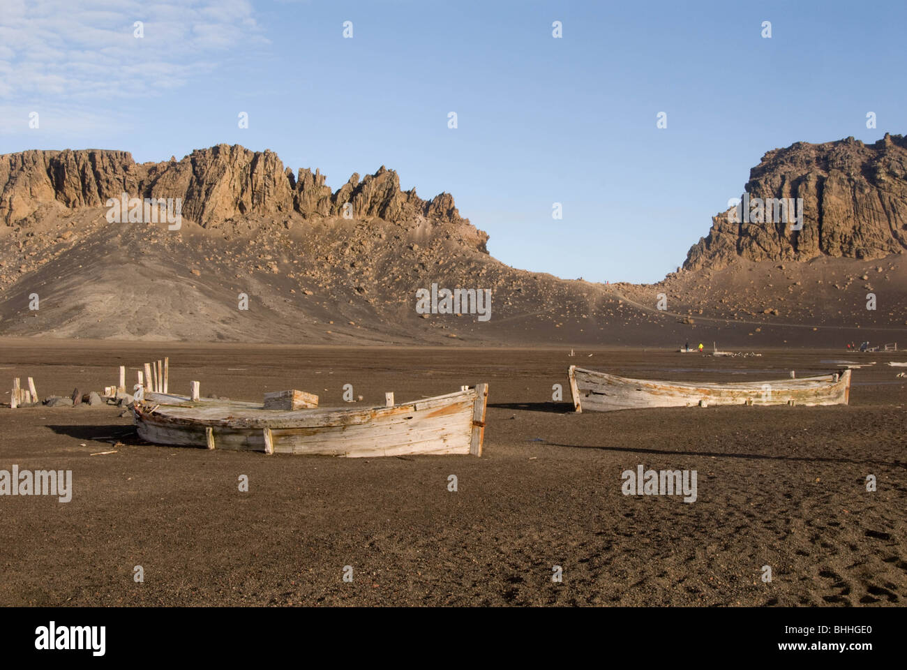Old wooden boats in front of Neptune's  Window, Deception Island, South Shetlands, Antarctica - Stock Image