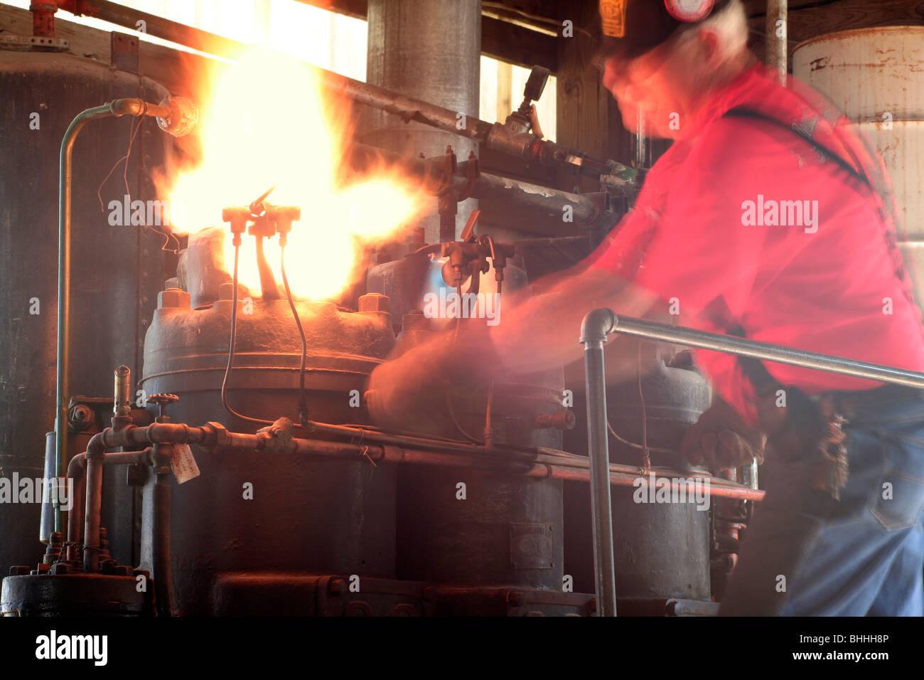 Lighting the glow plug burner on a semi-diesel oil engine - Stock Image