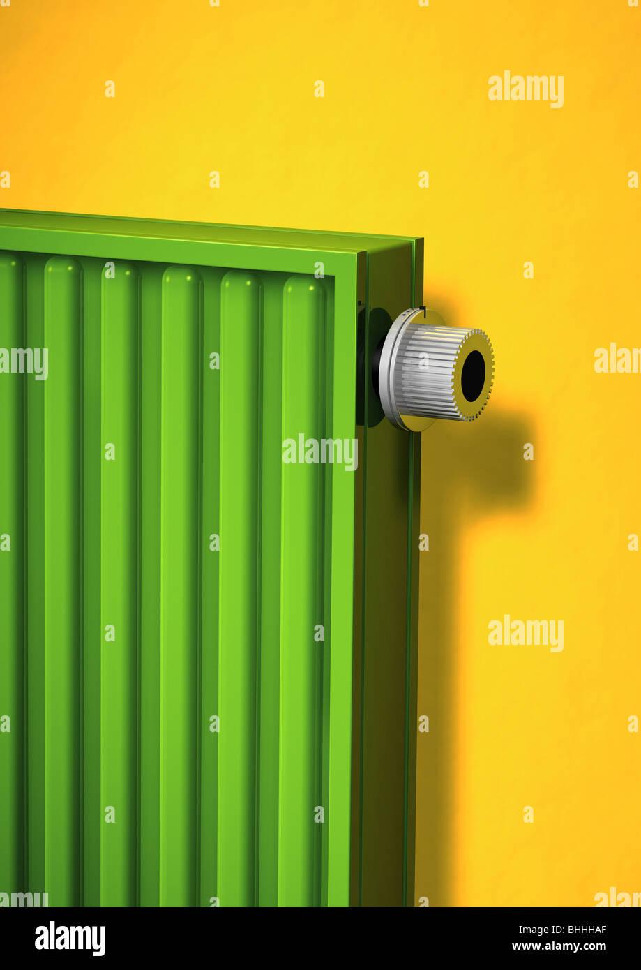 green radiator with themostatic valve - Gruener Heizkoerper mit Thermostatventil - Stock Image