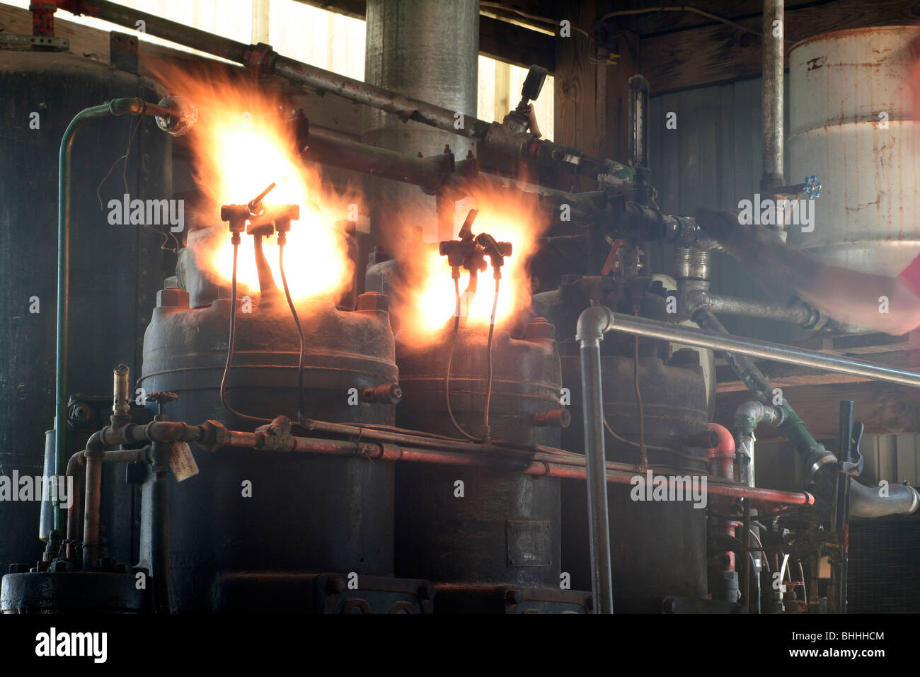 Lighting off cylinders on a semi-diesel oil engine - Stock Image