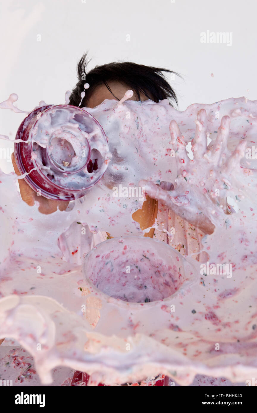 boy getting splashed by overflowing blender - Stock Image