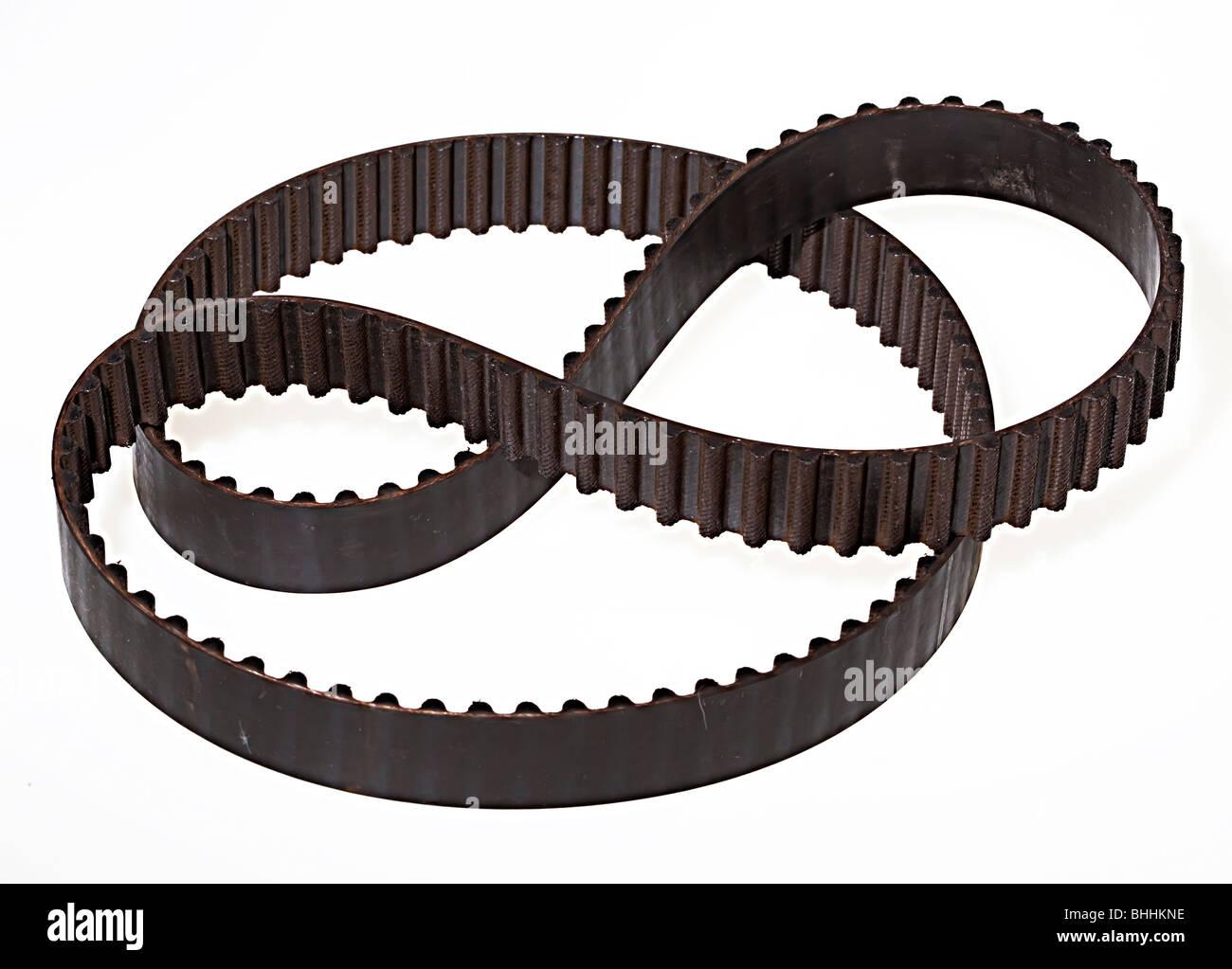 Used worn engine cam belt - Stock Image