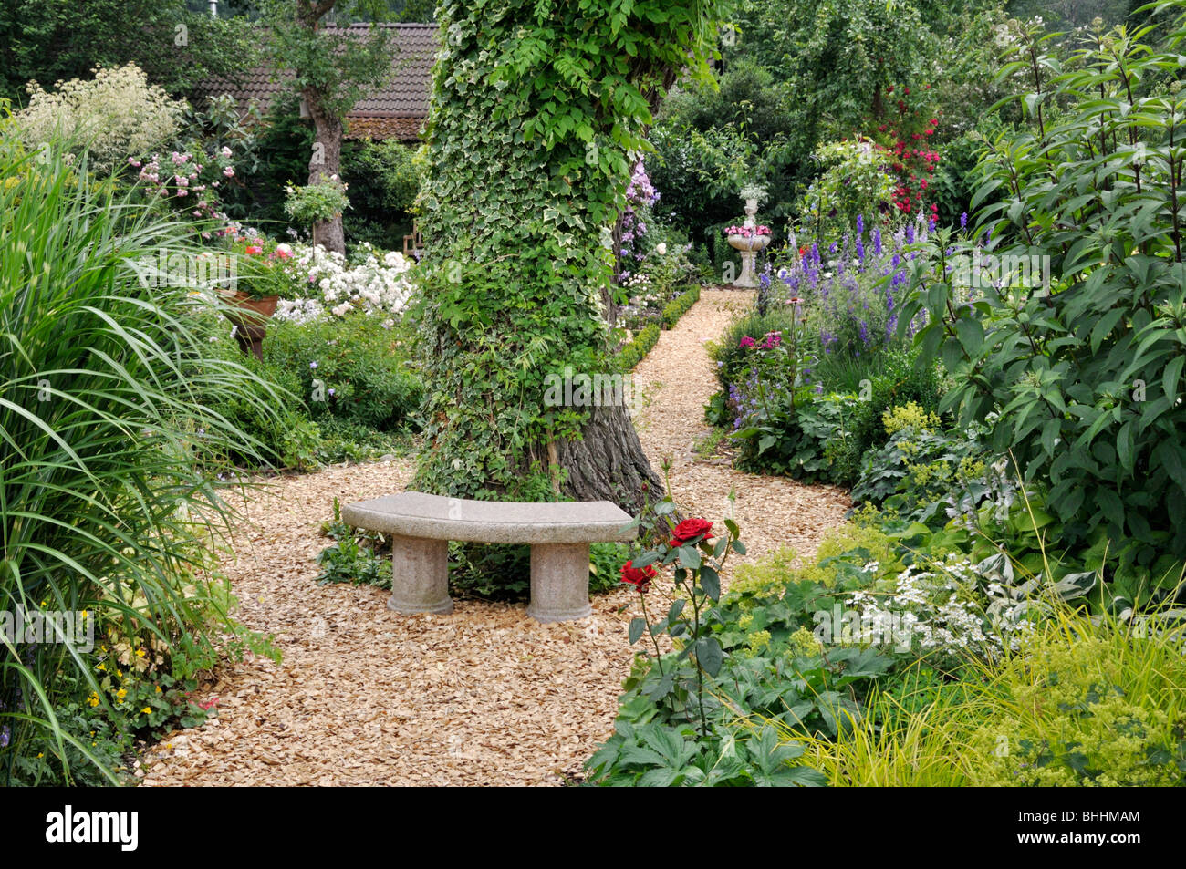 Small Stone Bench In A Perennial Garden Design Marianne And