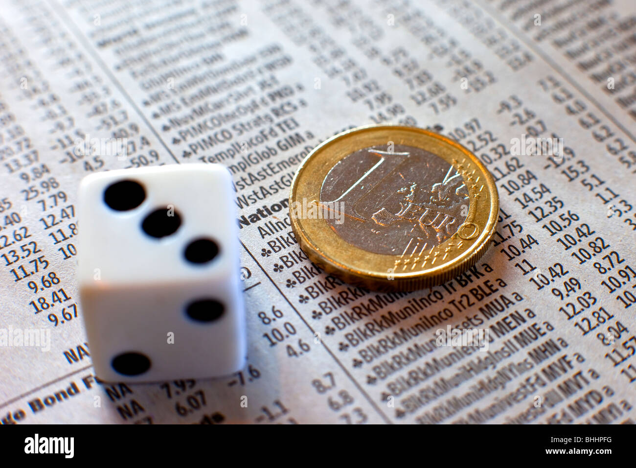 Dice, Euro and investment paper - Stock Image