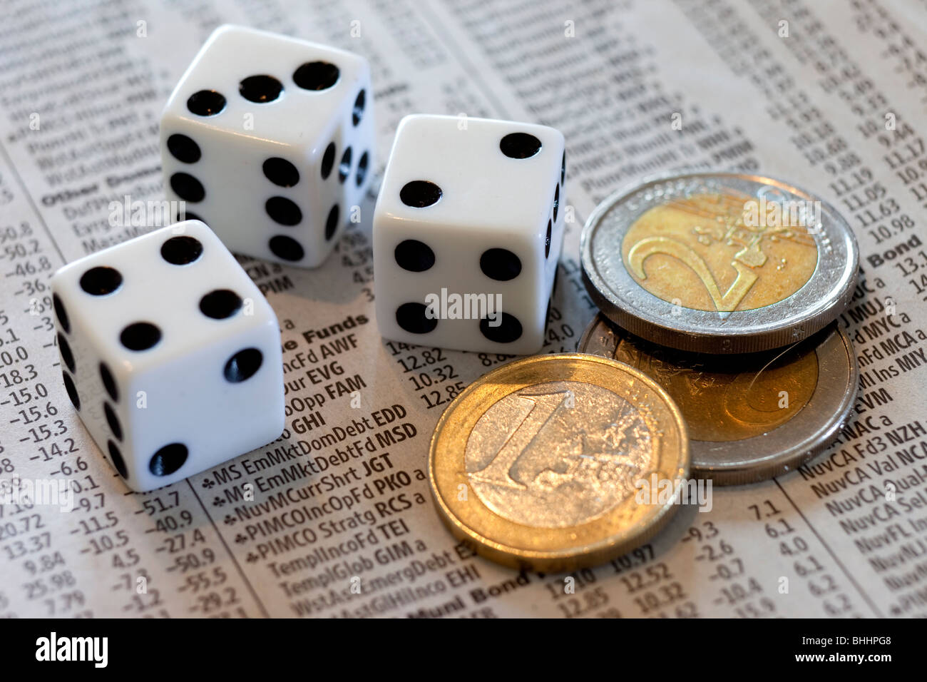 Dice, Euros and stock market report - Stock Image
