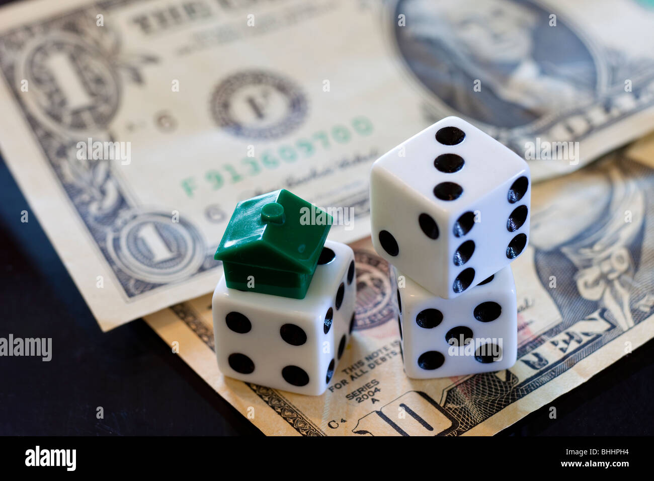 Dice, US Dollars and Monopoly house - Stock Image