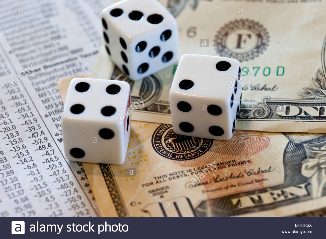Dice dollars and stock market report - Stock Image
