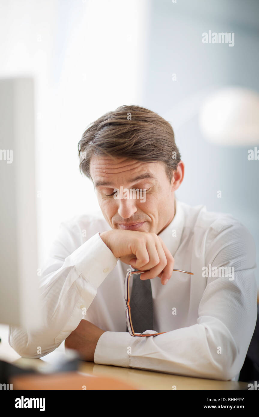 man being tired of bad news - Stock Image
