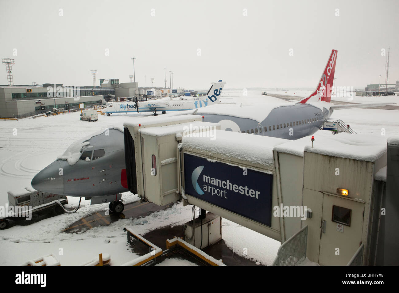 UK, England, Manchester Airport, snowed in jet 2 aircraft after heavy snowfall - Stock Image