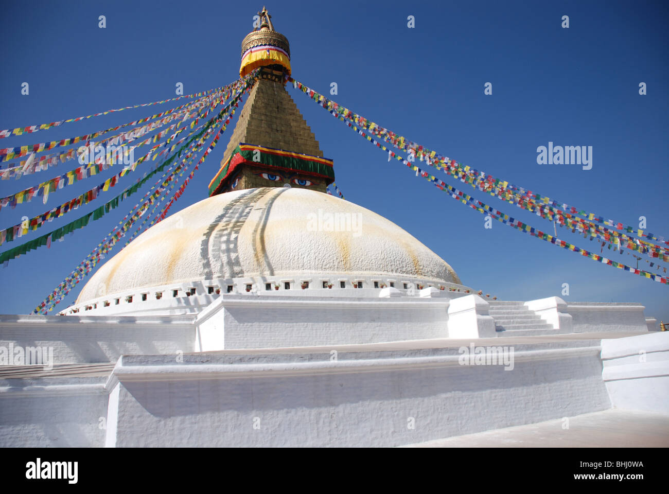 Nepal the Bodnath Stupa which is one of the largest Stupa in Asia is a site of pilgrimage for Buddhist pilgrims - Stock Image