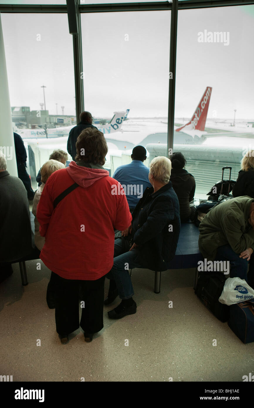 UK, England, Manchester Airport, delayed passengers snowed in after heavy snowfall - Stock Image