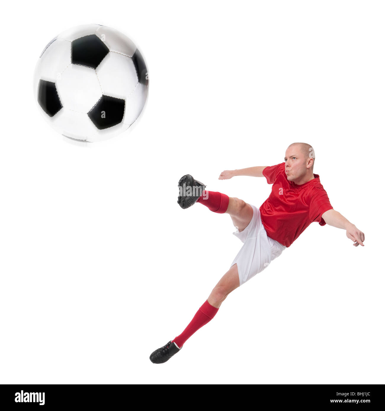Full isolated studio picture from a young soccer player with ball - Stock Image