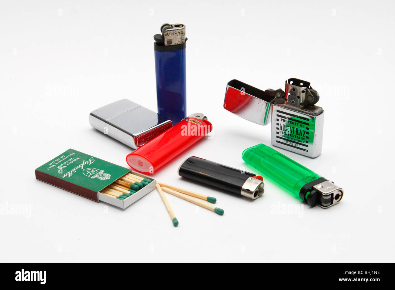 Lighters and matches on a white background. - Stock Image