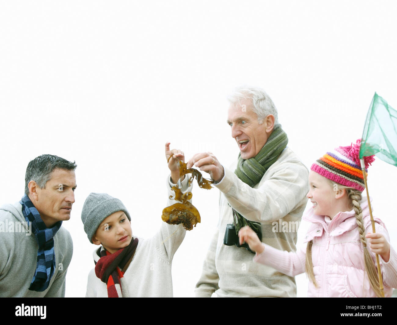 Generations Strolling on Beach - Stock Image