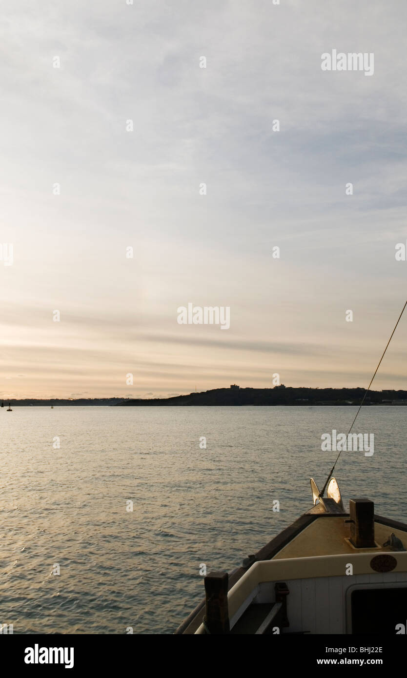 View from ferry across St Maves to Falmouth at dusk, Cornwall England UK - Stock Image
