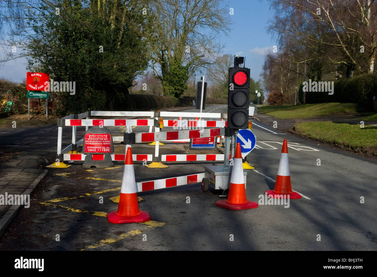 Traffic cones, barriers, temporary traffic lights at road