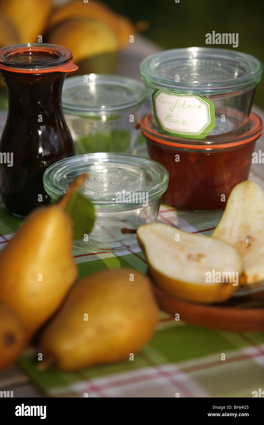 Pears and jam jars - Stock Image