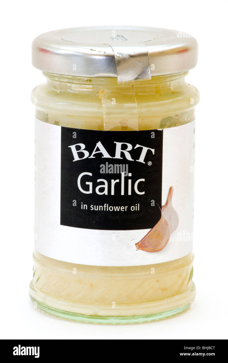A Glass Jar Of Bart Garlic In Sunflower Oil Isolated Against A White Background - Stock Image