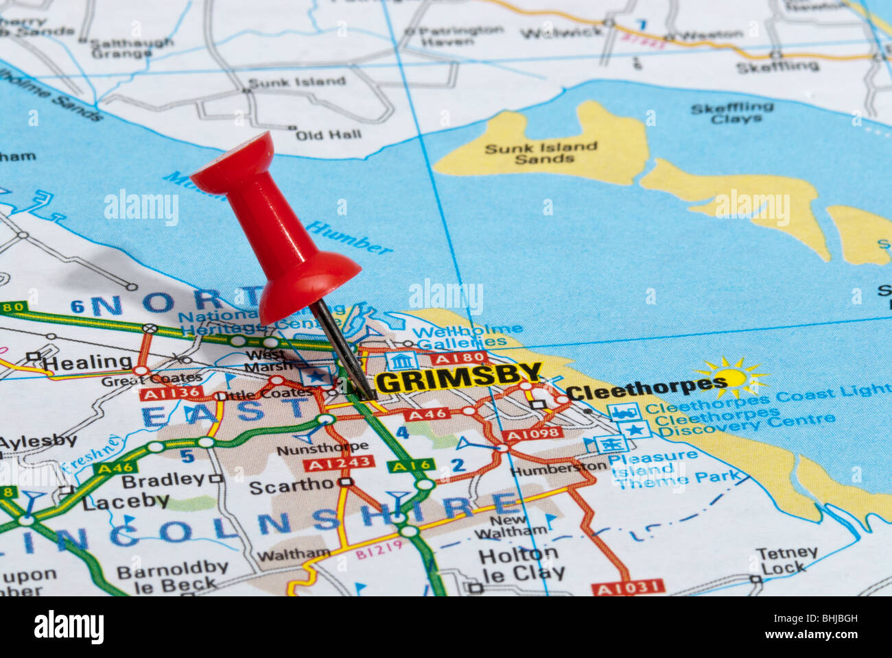 red map pin in road map pointing to city of Grimsby Stock Photo