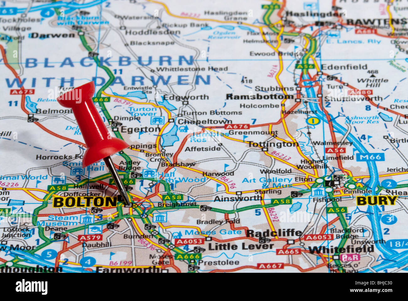 red map pin in road map pointing to city of Bolton - Stock Image