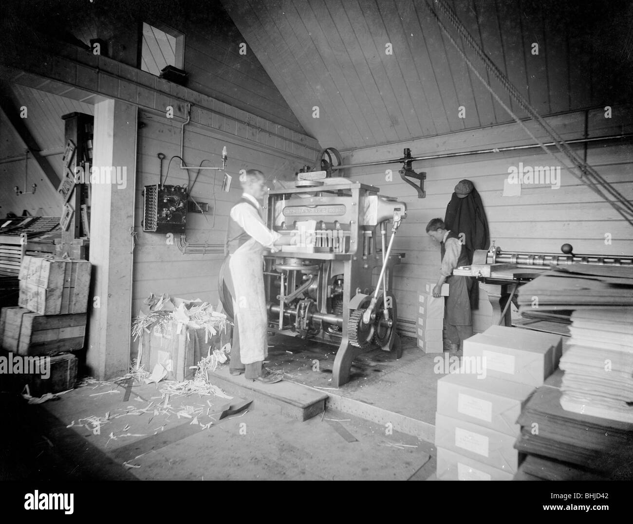 A man operates a printing press at the Church Army Press, Oxford, Oxfordshire, c1860-c1922. Artist: Henry Taunt - Stock Image