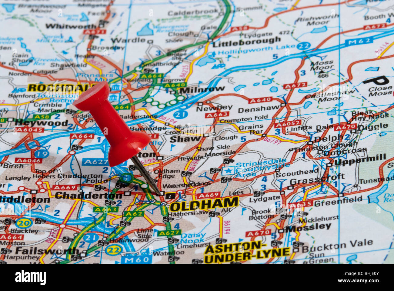 red map pin in road map pointing to city of Oldham Stock Photo