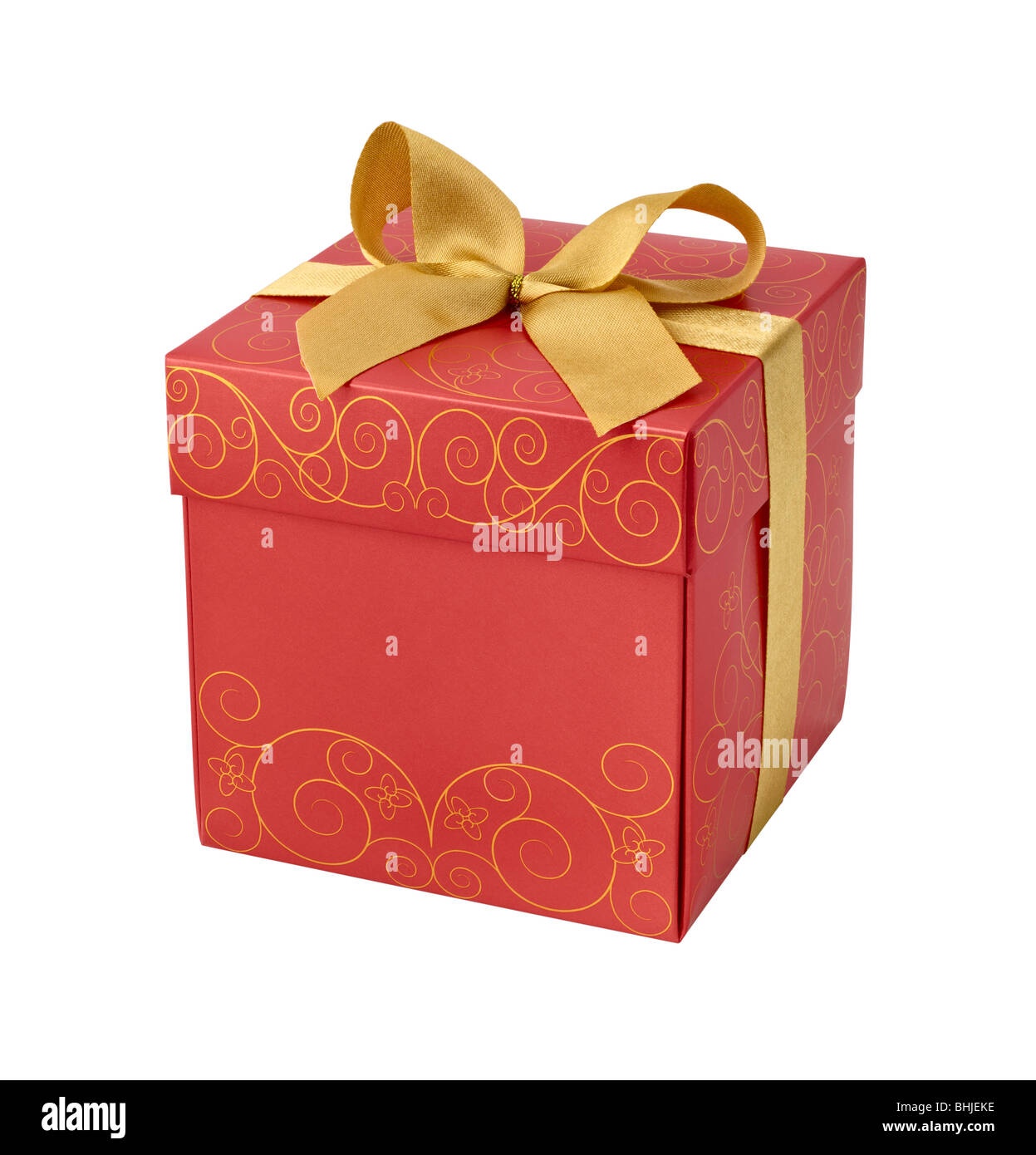 Red gift box with golden ribbon bow on white background - Stock Image
