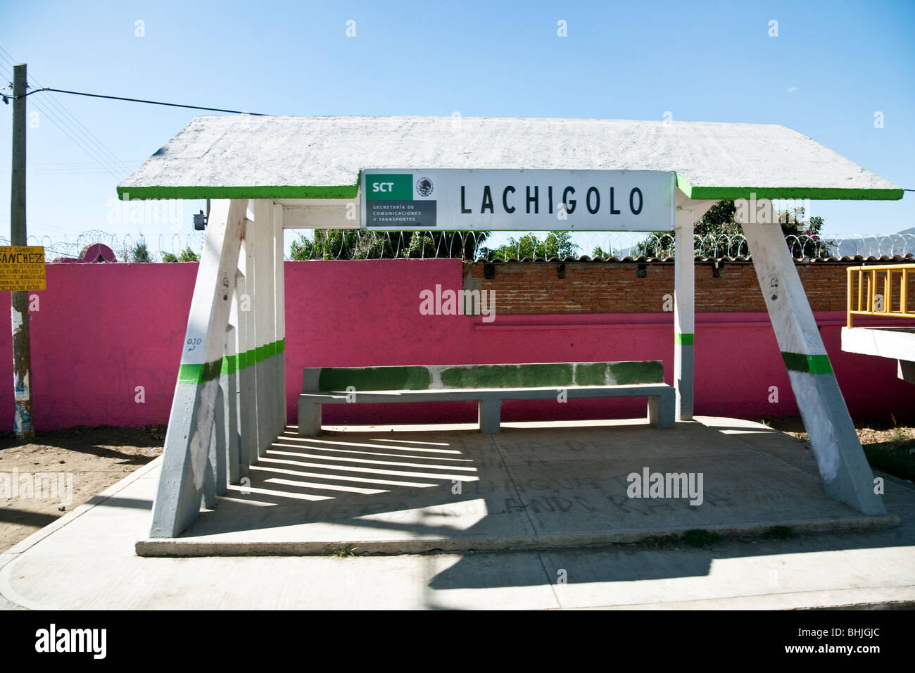 cheerfully painted concrete rural bus shelter on a beautiful sunny day in Oaxaca State Mexico - Stock Image
