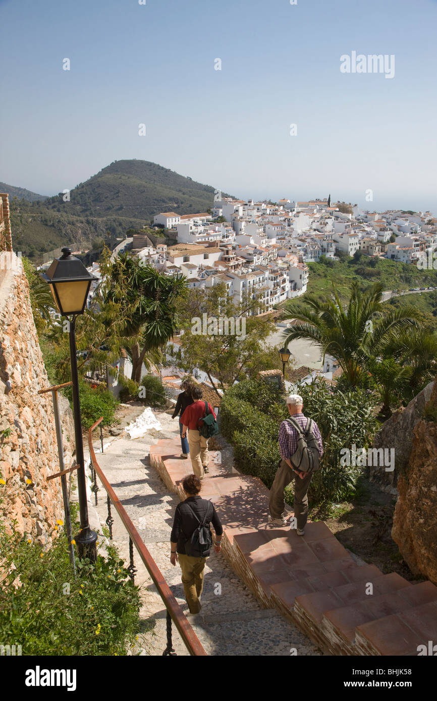 View over Frigiliana with walkers in foreground, Andalusia, Spain - Stock Image
