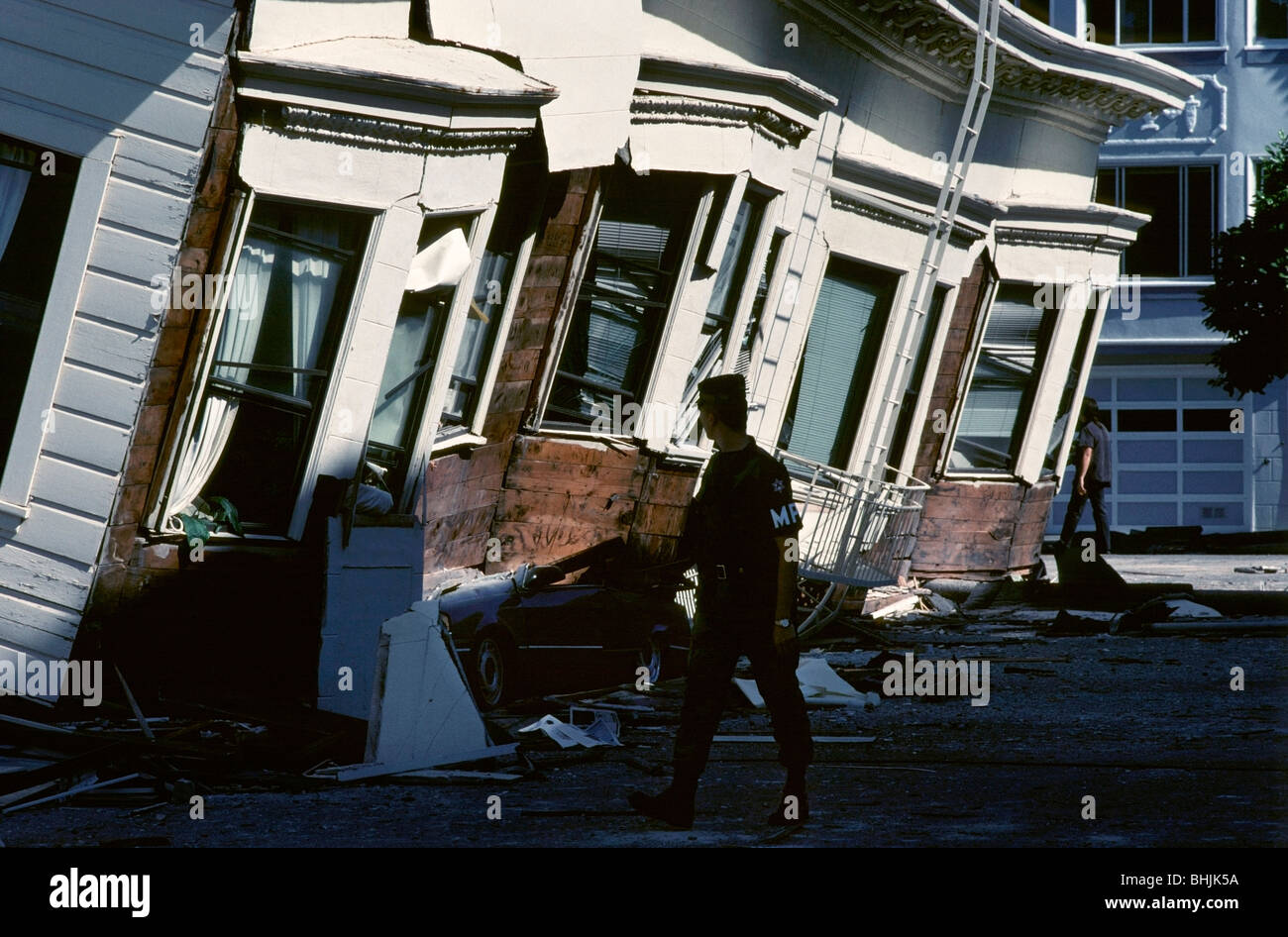 bcf0b540 Military policeman walks past a damaged apartment building in the Marina  District after the 1989 Loma