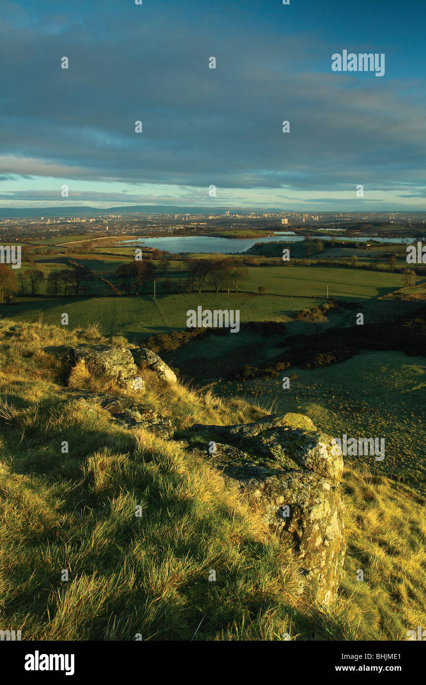 Glasgow at dawn from Duncarnock Fort Barrhead, Glasgow. Duncarnock Fort is known locally as The Craigie. - Stock Image