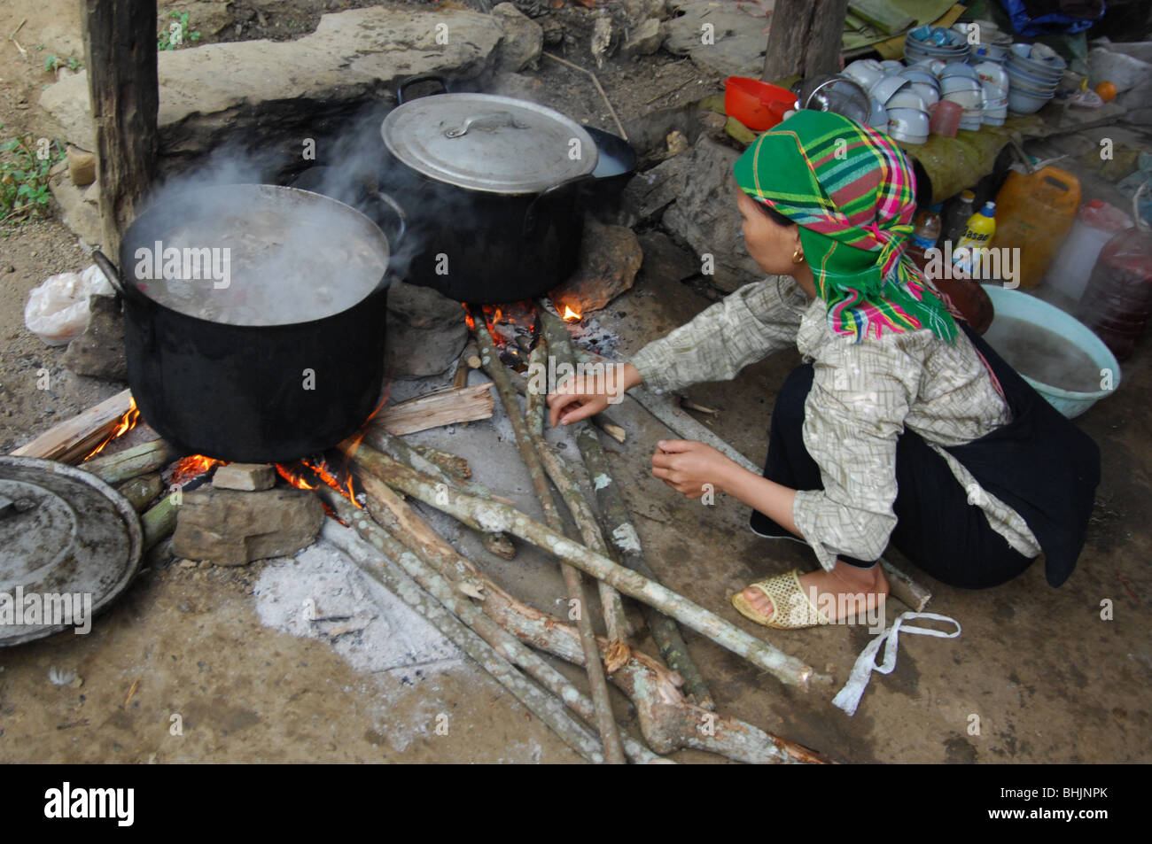 Flower Hmong Hill Tribe lady cooking a stew, tuesday market , Coc Ly, Lao Cai Province,  north west vietnam - Stock Image