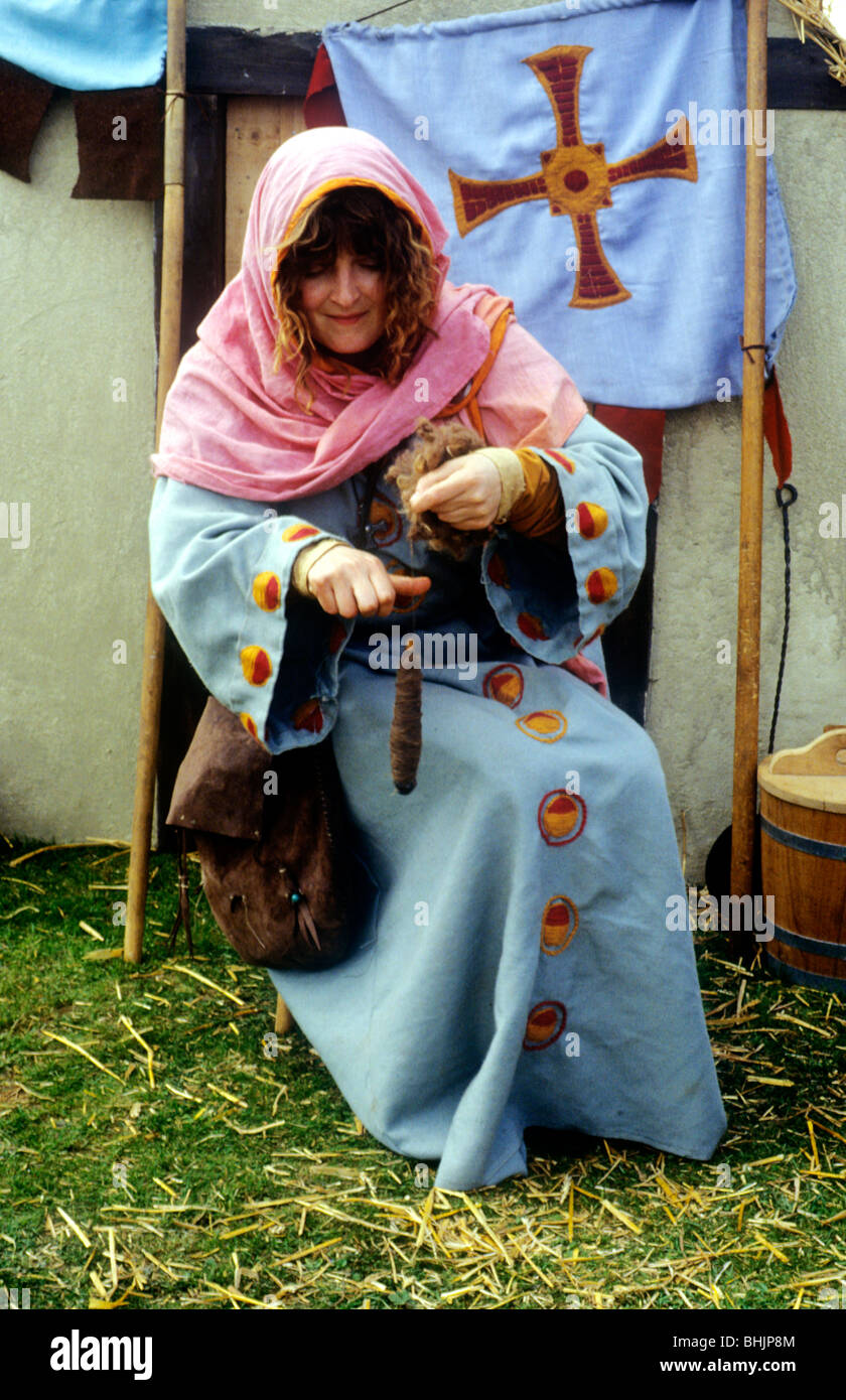 Anglo Norse Viking Saxon woman, spinning women in history England UK English British historical re-enactment costume - Stock Image