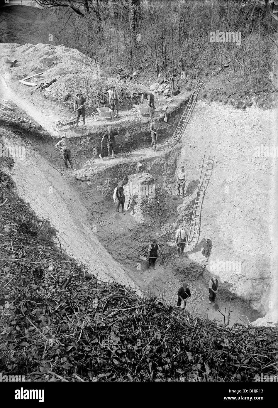 Excavation at Avebury, Wiltshire, 1922. Artist: Harold St George Gray - Stock Image