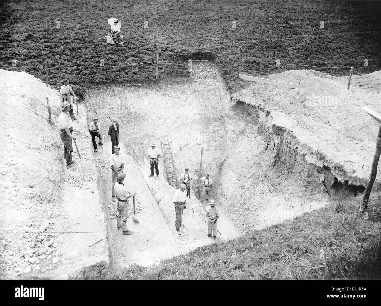 Excavation at Avebury, Wiltshire, 1909. Artist: Harold St George Gray - Stock Image