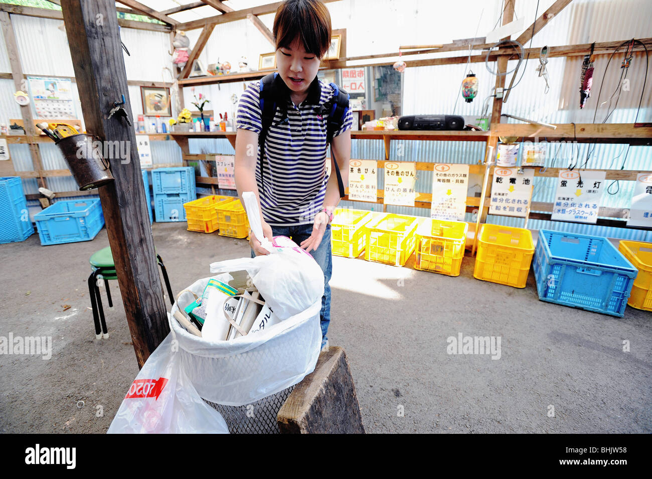 A resident disposes of waste at the waste disposal center in Stock