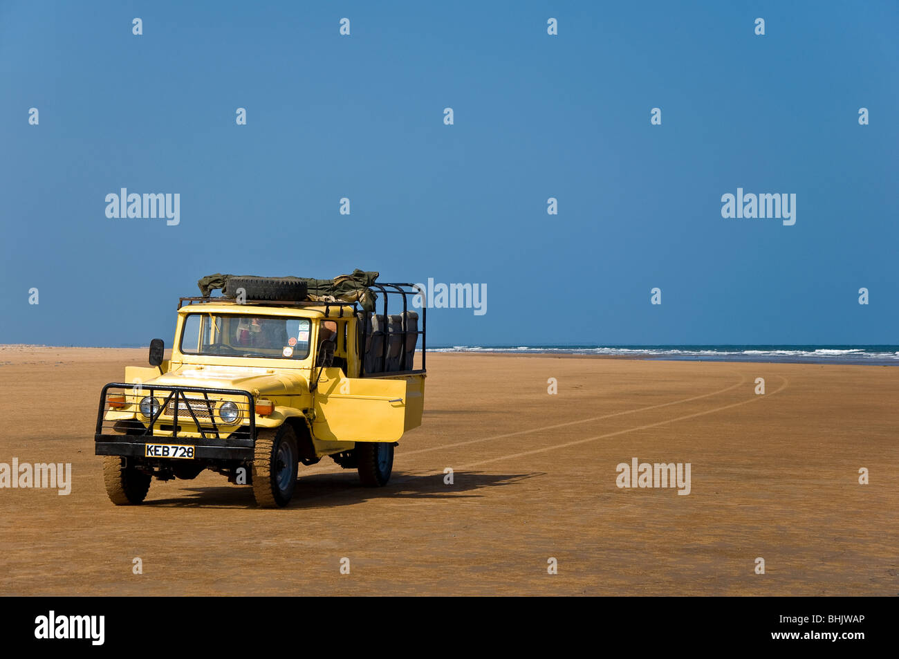 Jeep on a deserted beach, Malindi, Kenya, Africa - Stock Image