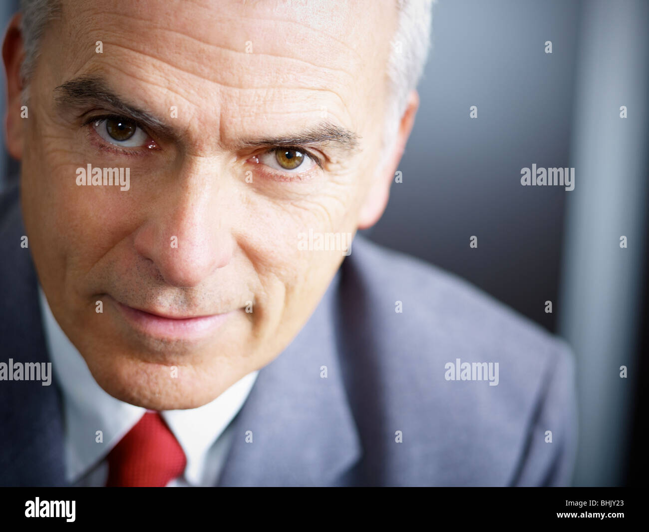 closeup of mature business man looking at camera. Copy space - Stock Image