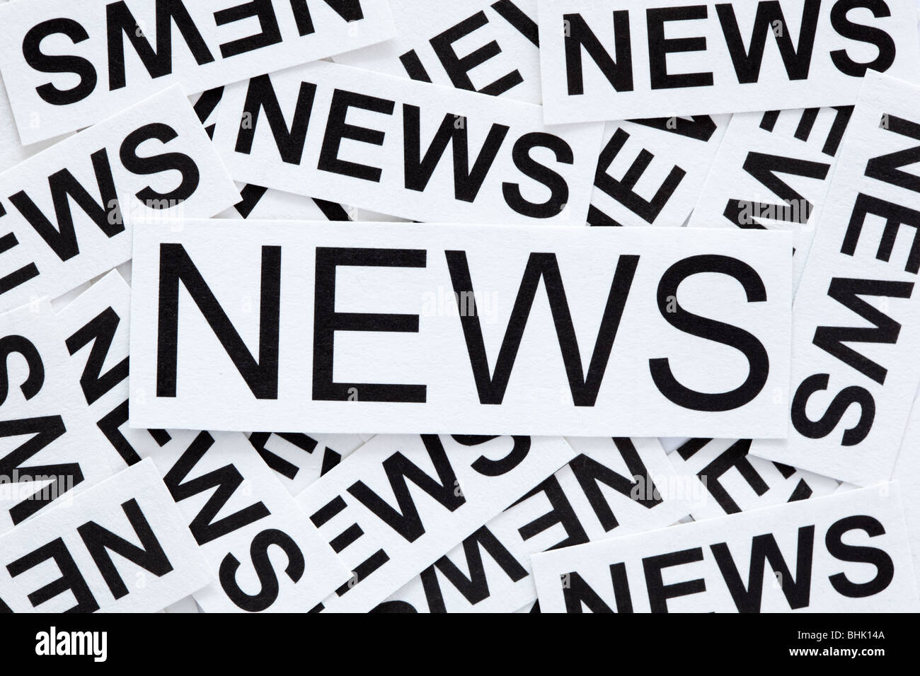 News concept.Many paper labels with word 'NEWS' - Stock Image