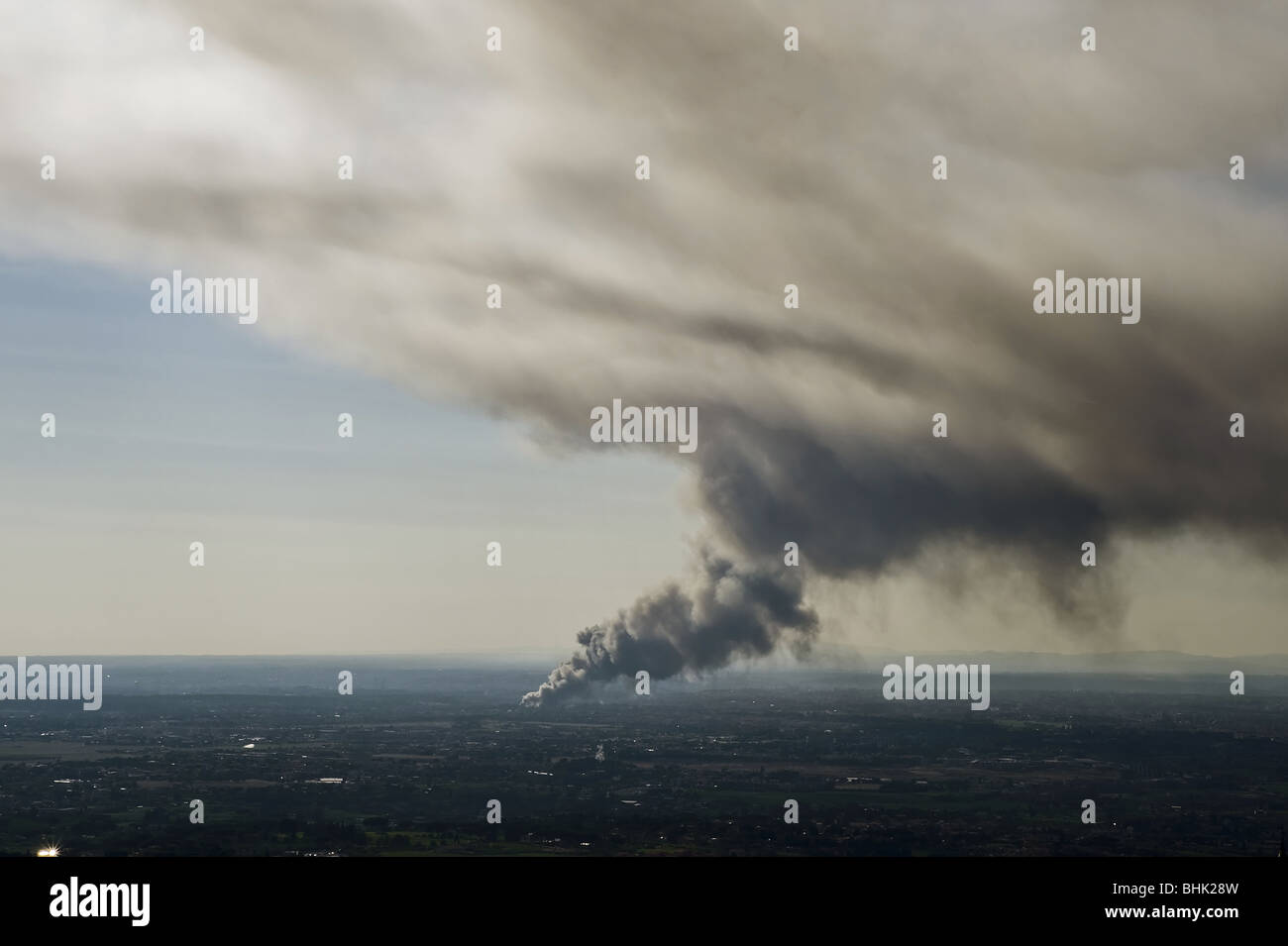 Smoke from a fire in the distance Stock Photo