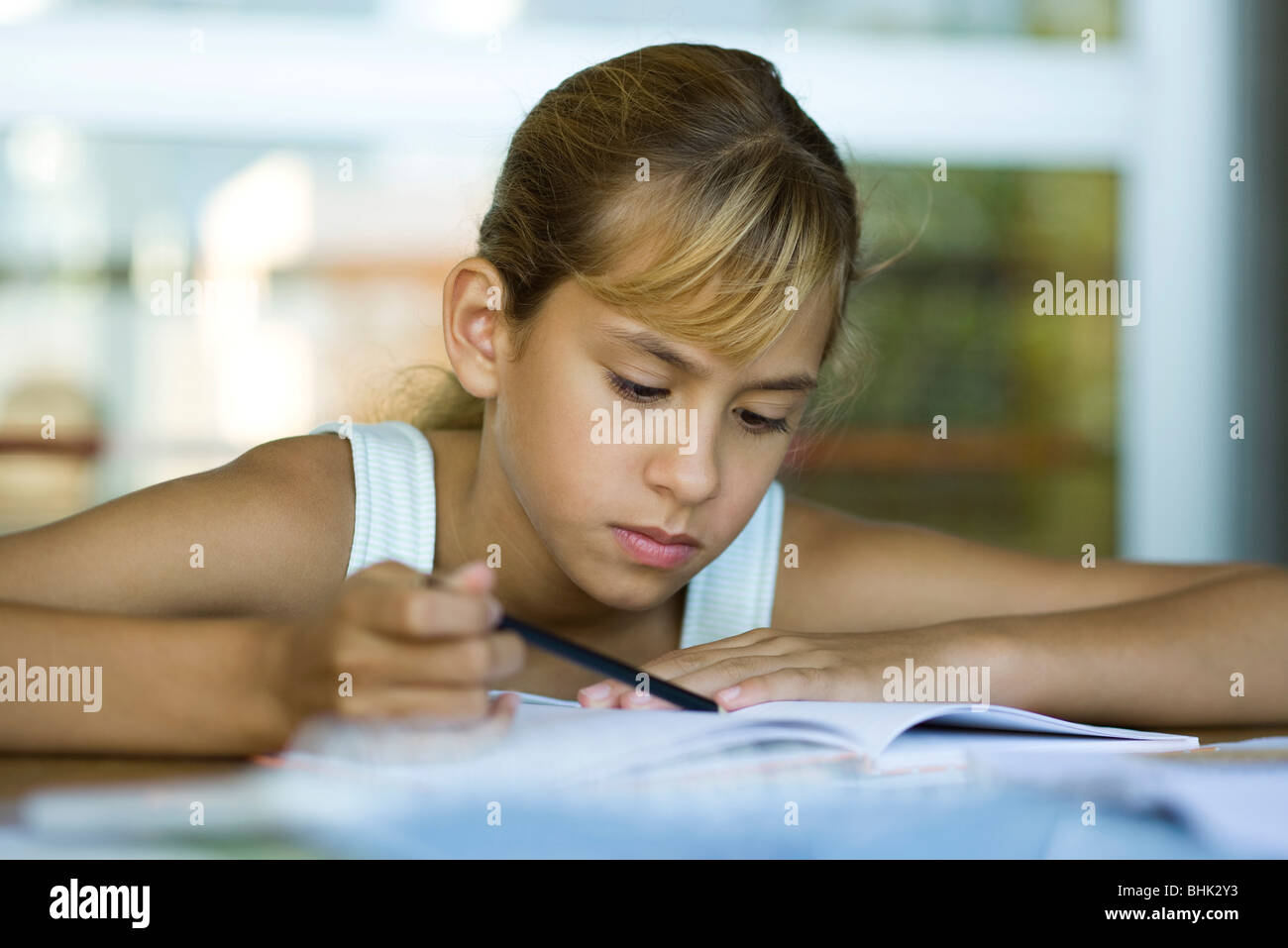 Female junior high student studying - Stock Image