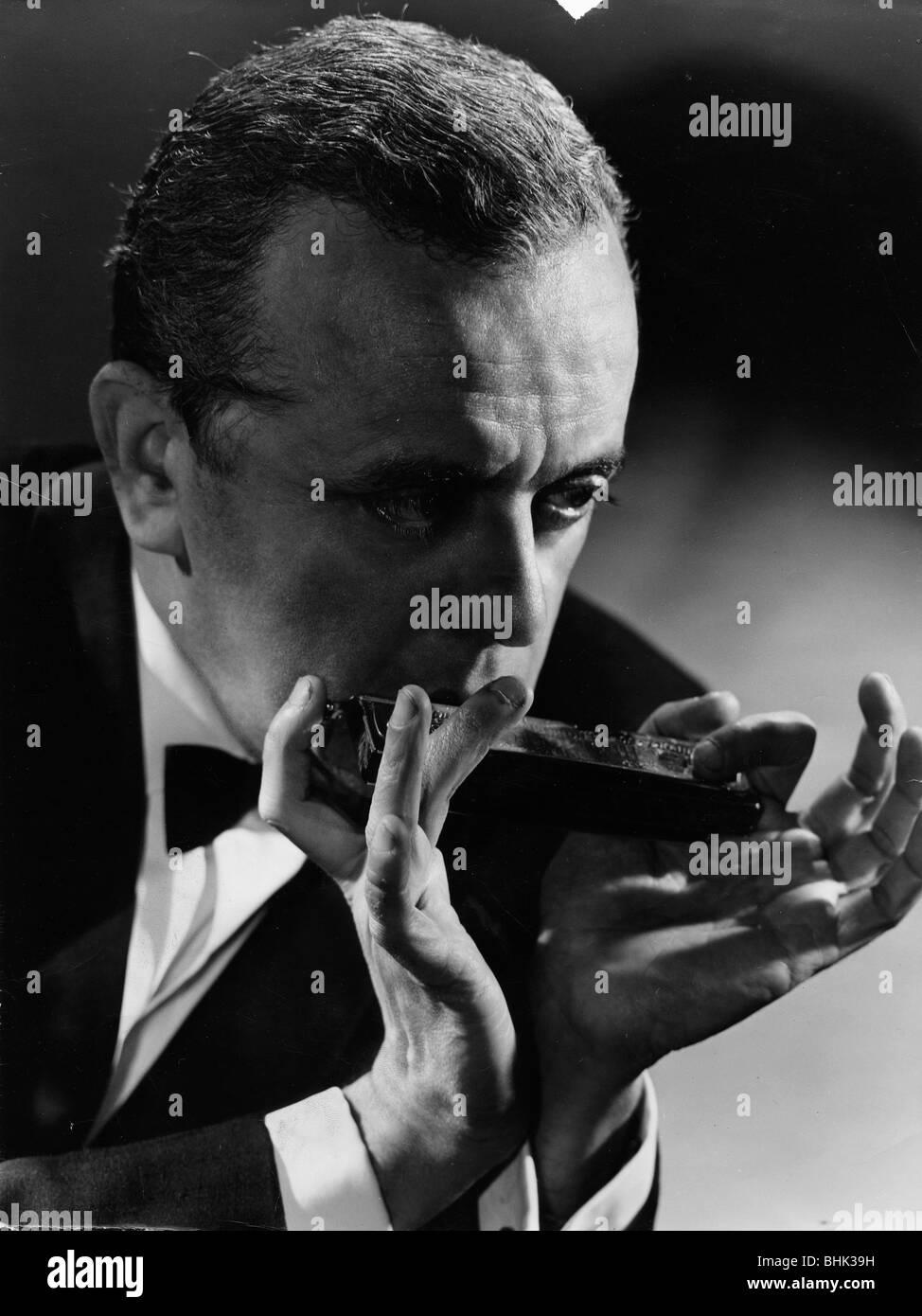 Larry Adler (1914-2001), Musician, playing his harmonica, c1940s. - Stock Image