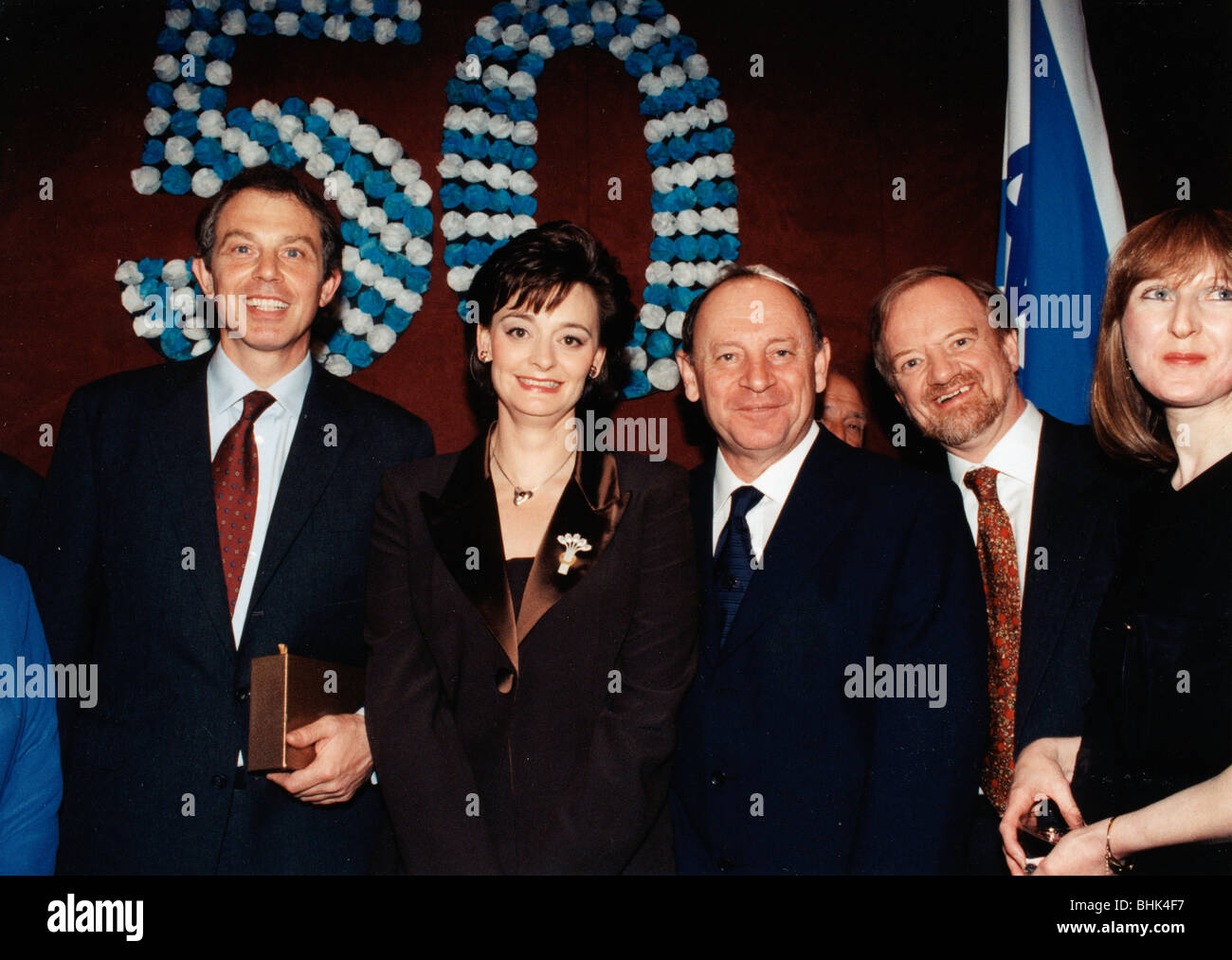 Robin Cook (1946- ), Tony Blair (1953- ) and Cherie Blair at a ceremony, 1998. Artist: Sidney Harris Stock Photo