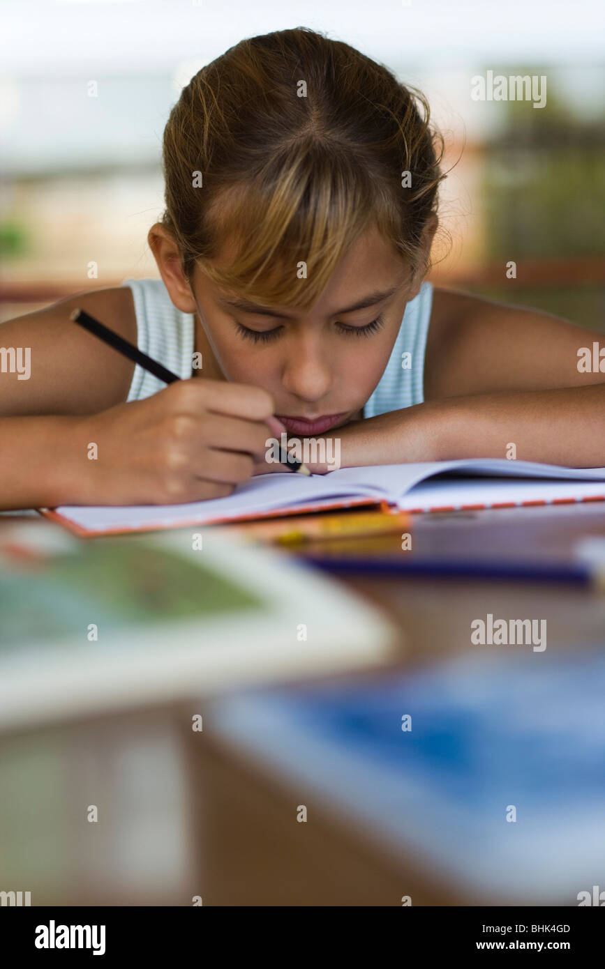 Elementary school student concentrating on school work - Stock Image