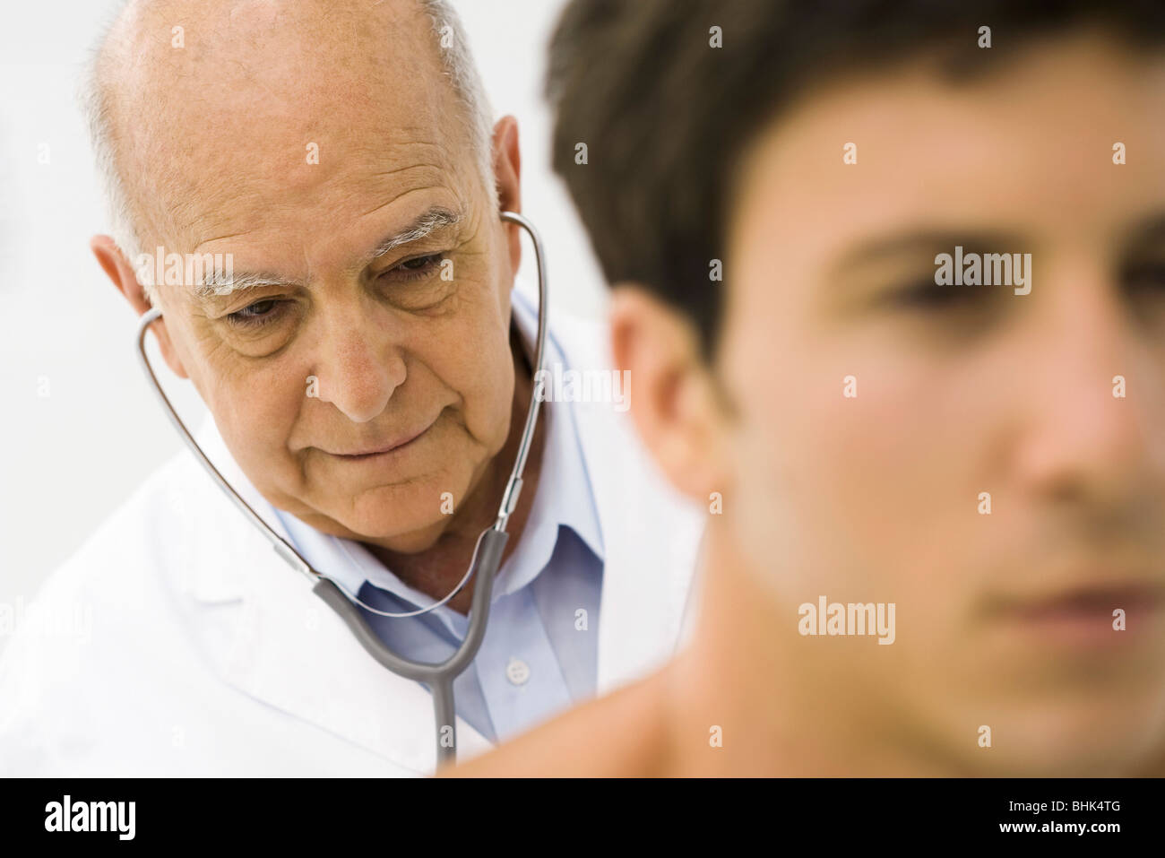 Doctor conducting medical exam - Stock Image