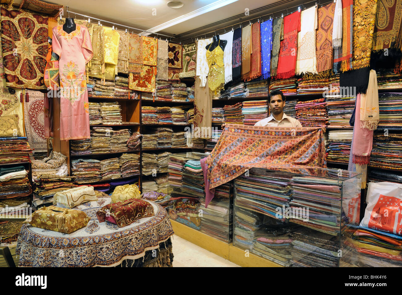 Salesman in his Shop. Sharjah Central Souq, United Arab Emirates - Stock Image