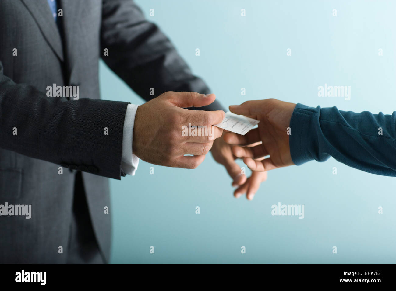 Handing out business cards stock photos handing out business cards businessman handing business card to client stock image colourmoves