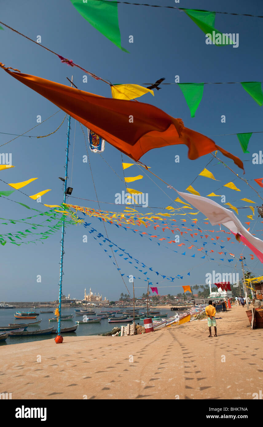 India, Kerala, Kovalam, Vizhinjam village seafront, colourful bunting flags outside St Mary's old fisherman's - Stock Image